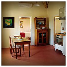 The kitchen area with quaint antique Cape cottage furniture.