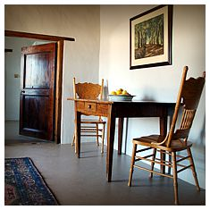 Cottage interior with Cape antiques and Cedarwood door.