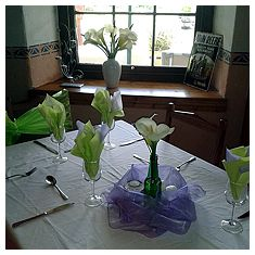 Table set for a wedding reception in the restaurant.