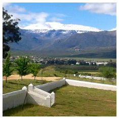 Snow-covered Sneeukop, the highest Cederberg peak behind Citrusdal, seen from the farm yard in late winter.